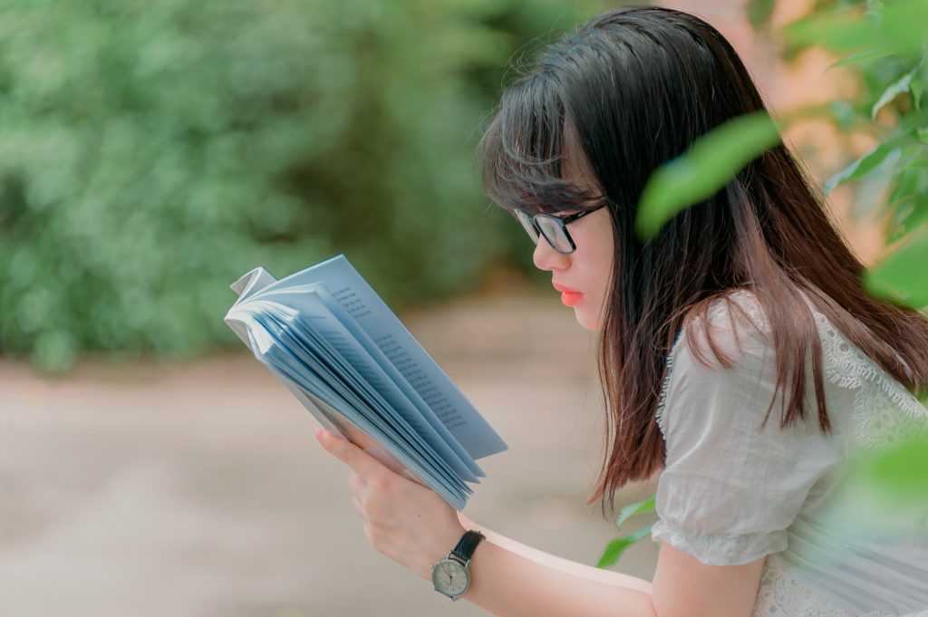 Canva - Close-Up Photography of Girl Reading Book
